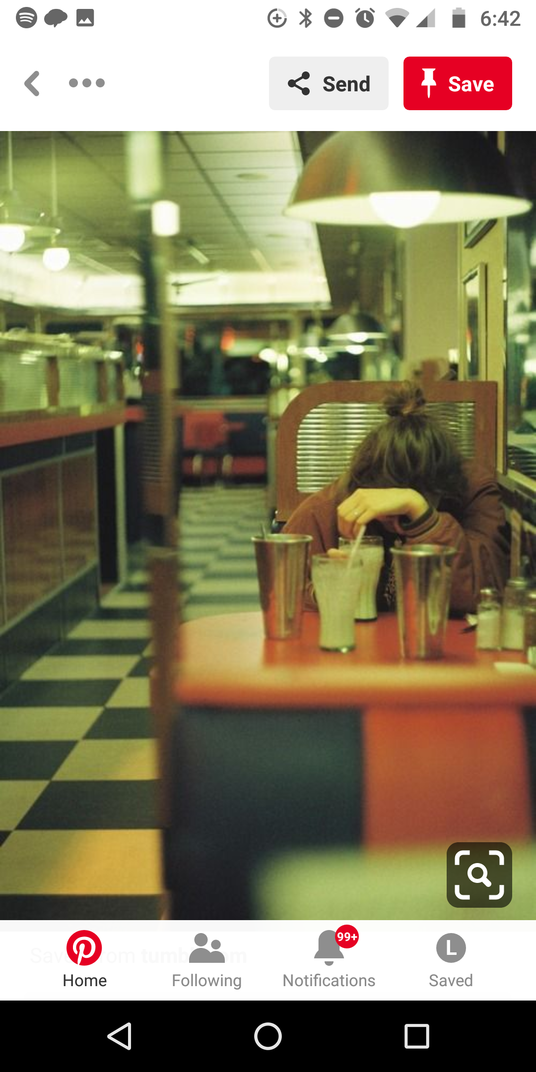 woman alone in diner.png